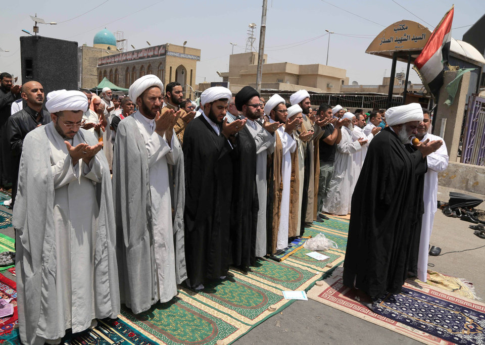 Photo - Followers of Shiite cleric Muqtada al-Sadr attend open-air Friday prayers in the Shiite stronghold of Sadr City, Baghdad, Iraq, Friday, July 4, 2014. (AP Photo/Karim Kadim)