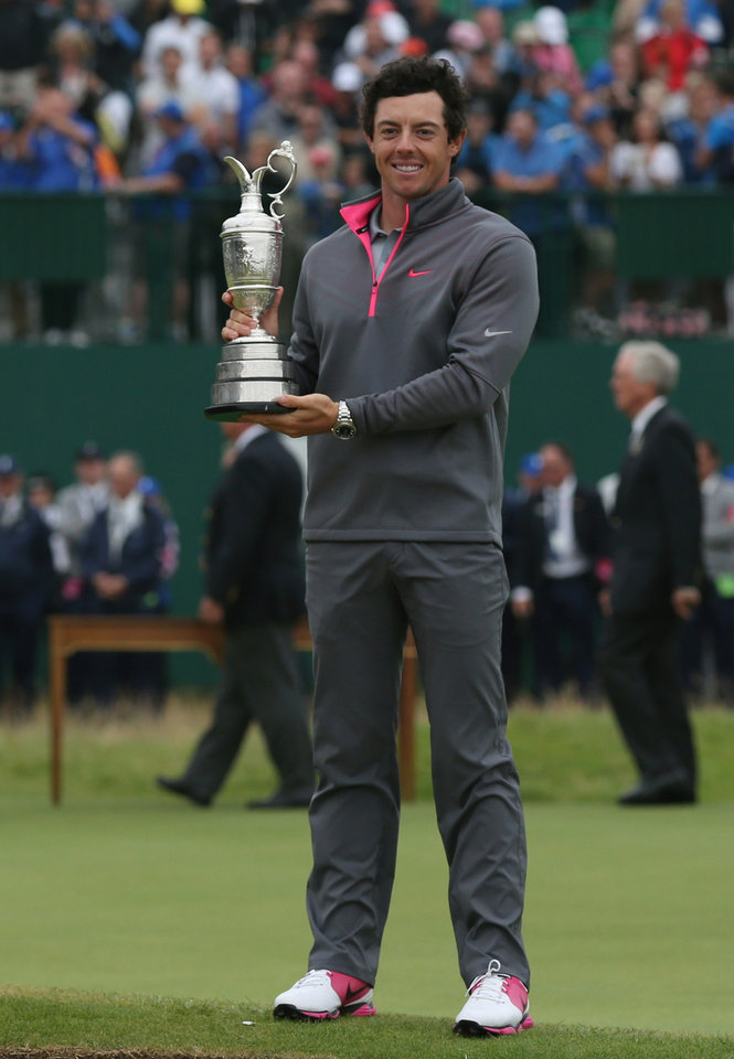 Photo - Rory McIlroy of Northern Ireland holds the Claret Jug trophy after winning the British Open Golf championship at the Royal Liverpool golf club, Hoylake, England, Sunday July 20, 2014.  (AP Photo/Scott Heppell)
