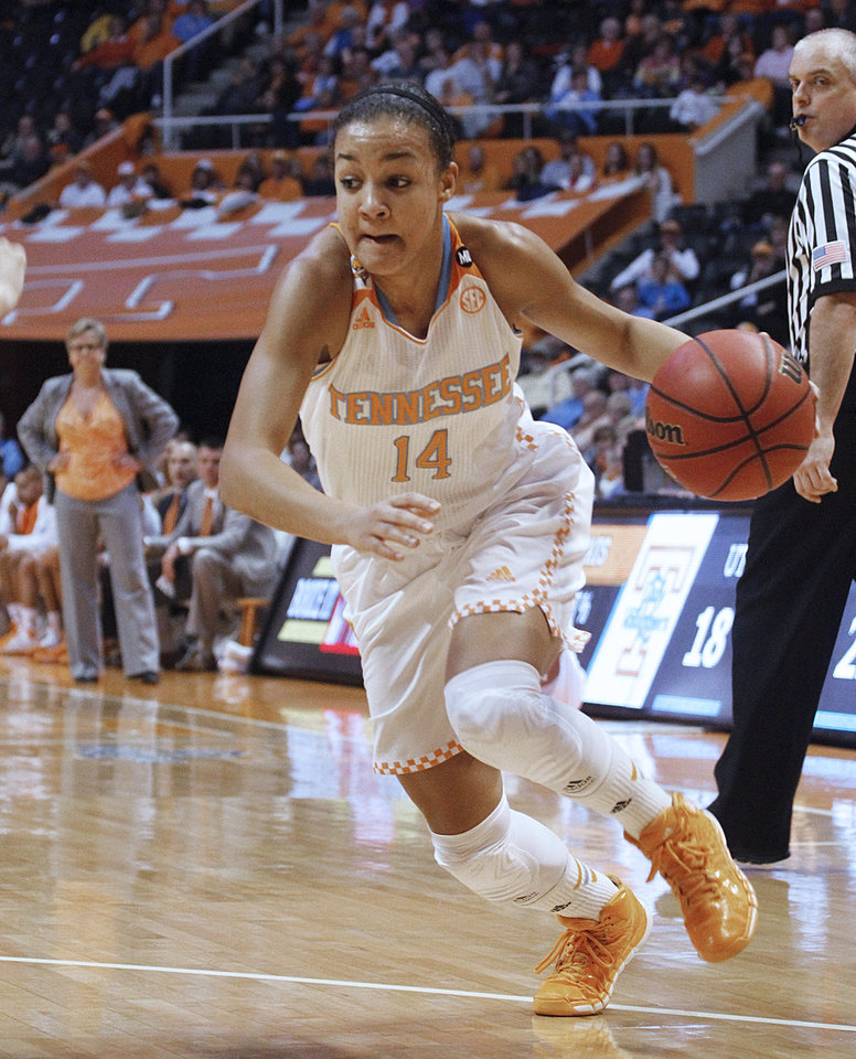 Photo - Tennessee guard Andraya Carter drives to the basket while coach Holly Warlick watches the play during the first half of an NCAA college basketball game against Arkansas, Thursday, Jan. 30, 2014, in Knoxville, Tenn. (AP Photo/Lisa Norman-Hudson)