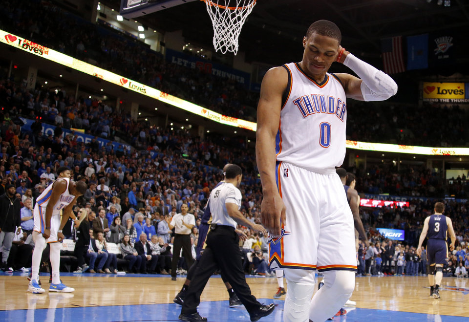 Photo - Oklahoma City's Russell Westbrook (0) walks away after a missed basket late in an NBA game between the Oklahoma City Thunder and the New Orleans Pelicans at Chesapeake Energy Arena on Friday, Feb. 6, 2015. Photo by Bryan Terry, The Oklahoman