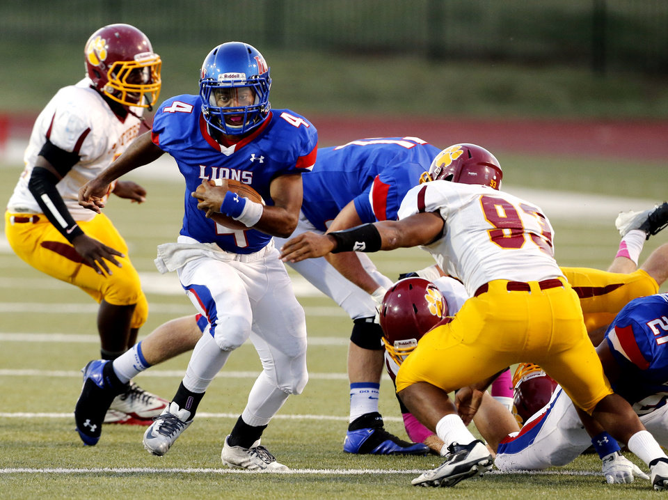Moore's Jordan Norris (4) runs the ball as the Moore High School Lions play the Putnam City North Panthers in high school football on Thursday, Oct. 3, 2013, in Moore, Okla.  Photo by Steve Sisney, The Oklahoman