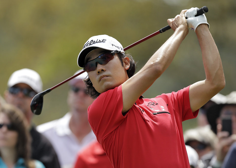 Photo - Kevin Na tees off on the second hole during the final round of the Valspar Championship golf tournament at Innisbrook, Sunday, March 16, 2014, in Palm Harbor, Fla. (AP Photo/Chris O'Meara)