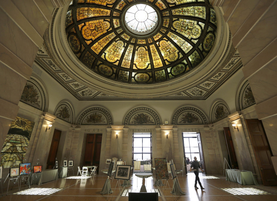 """Photo - This May 1, 2014 photo shows the Chicago Cultural Center's Healy and Millet stained glass dome that is a 40-foot-diameter dome with some 50,000 pieces of glass in an intricate Renaissance pattern and is located in the Grand Army of the Republic rotunda at the center. In 2012, Mayor Rahm Emanuel promised to transform Chicago from the foundation up with mega projects bankrolled entirely by private investors in exchange for a chunk of the profits. The Chicago Infrastructure Trust was born as a """"breakout strategy"""" for modernizing buildings, bridges and broadband without waiting for Washington handouts. The city's first deal, known as Retrofit Chicago, with Bank of America, includes landmarks like City Hall, the Harold Washington Library, and the Cultural Center, and is expected to generate annual utility bill savings of $1.5 million. (AP Photo/Charles Rex Arbogast)"""