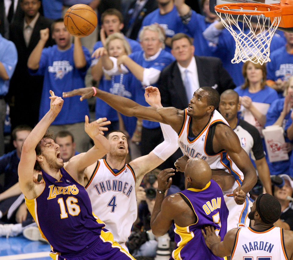 Photo - GAME THREE / L.A. LAKERS: Oklahoma City's Serge Ibaka and Nick Collison, left, defend Pau Gasol of the Lakers during the NBA basketball game between the Los Angeles Lakers and the Oklahoma City Thunder in the first round of the NBA playoffs at the Ford Center in Oklahoma City, Thursday, April 22, 2010. Photo by Bryan Terry, The Oklahoman ORG XMIT: KOD