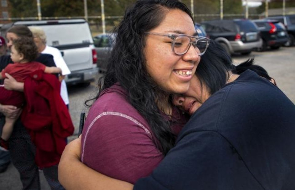 Photo - Tess Harjo, left, hugs her aunt Sarah Taylor as they celebrate after Harjo was  released from the Dr. Eddie Warrior Correctional Facility on Monday, Nov. 4, 2019 in Taft, Okla. Governor Kevin Stitt greeted an estimated 70 women whose sentences he commented from the facility. [Chris Landsberger/The Oklahoman]