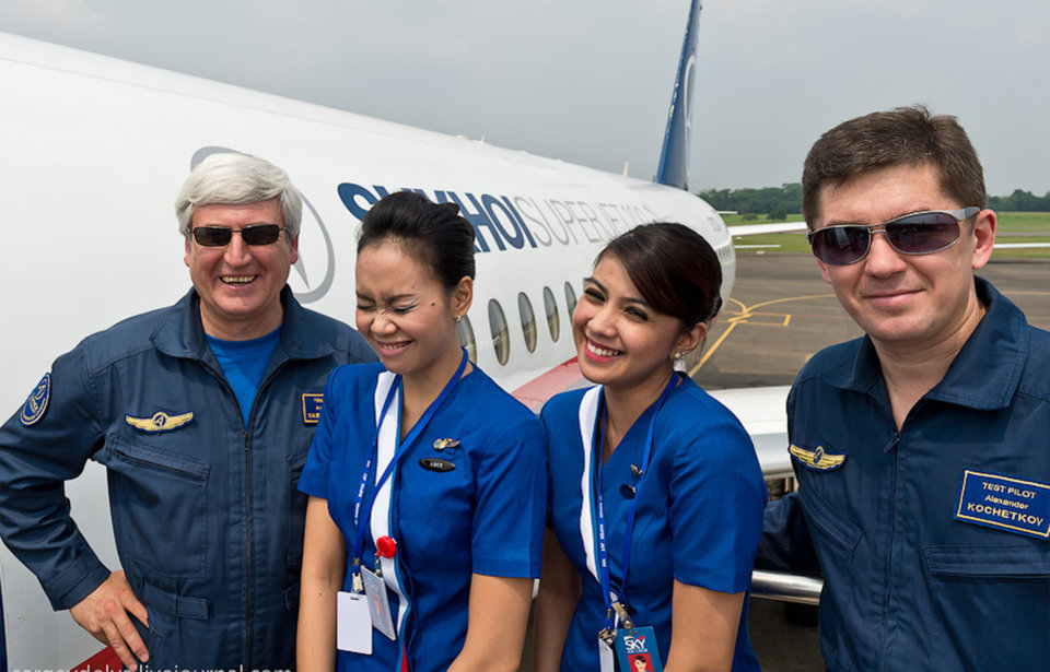 In this photo released by Sergey Dolya, captain pilot Alexander Yablontsev, left and first officer Alexander Kotchetkov pose with unidentified cabin crew next to their Sukhoi Superjet-100 prior to a demonstration flight at Halim Perdanakusuma airport in Jakarta, Indonesia, Wednesday, May 9, 2012. The Russian-made jet plane with 50 people on board, including eight Russians and an American, has gone missing during a second demonstration flight of the day near Jakarta, Indonesian government officials said Wednesday.(AP Photo/Sergey Dolya) NO SALES