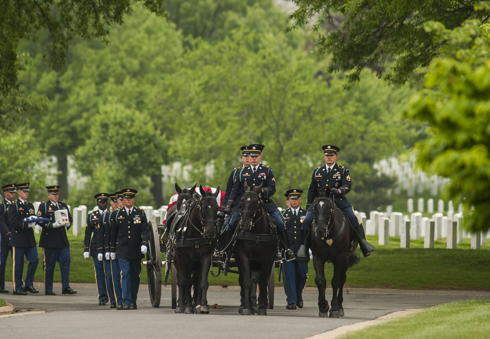 Photo - A caisson carries the remains of U.S. Army 1st Lt. Zuinglius K. McCormack, a Civil War veteran, during committal services at Arlington National Cemetery on Thursday, May 9, 2013 in Arlington, Va.  Arlington National Cemetery dedicated its ninth columbarium court by conducting a joint full honors committal service for six unclaimed remains of veterans from all branches of the Armed Forces. (AP Photo/Kevin Wolf)