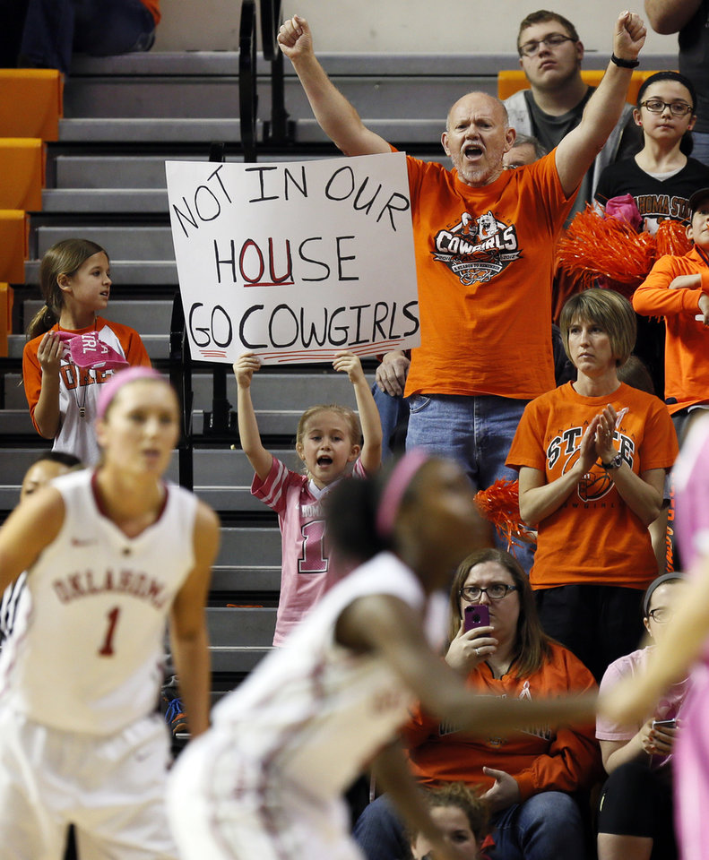 Photo - Oklahoma State fans cheer for the Cowgirls in the second half during the women's Bedlam college basketball game between the OU Sooners and the OSU Cowgirls at Gallagher-Iba Arena in Stillwater, Okla., Sunday, Feb. 16, 2014. OSU won, 73-57. Photo by Nate Billings, The Oklahoman