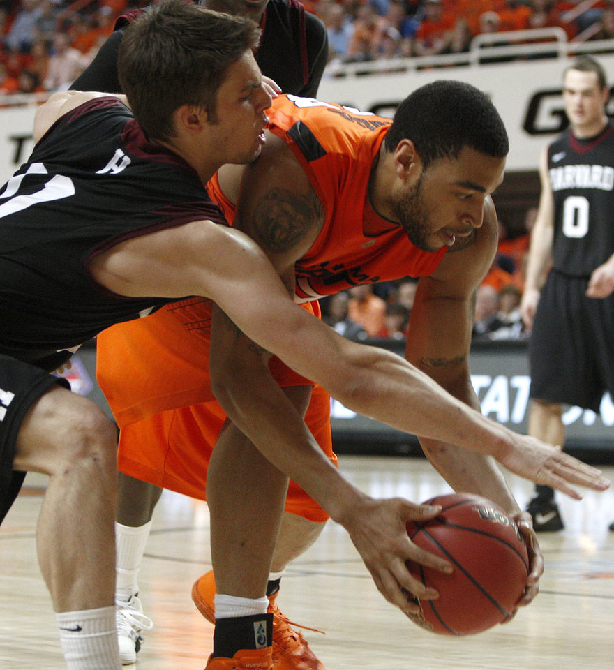 Photo - Oklahoma State's Marshall Moses (33) and Harvard's Oliver McNally (11) go for the ball during a first-round NIT college basketball game between Oklahoma State University (OSU) and Harvard at Gallagher-Iba Arena in Stillwater, Okla., Tuesday, March 15, 2011. Photo by Bryan Terry, The Oklahoman