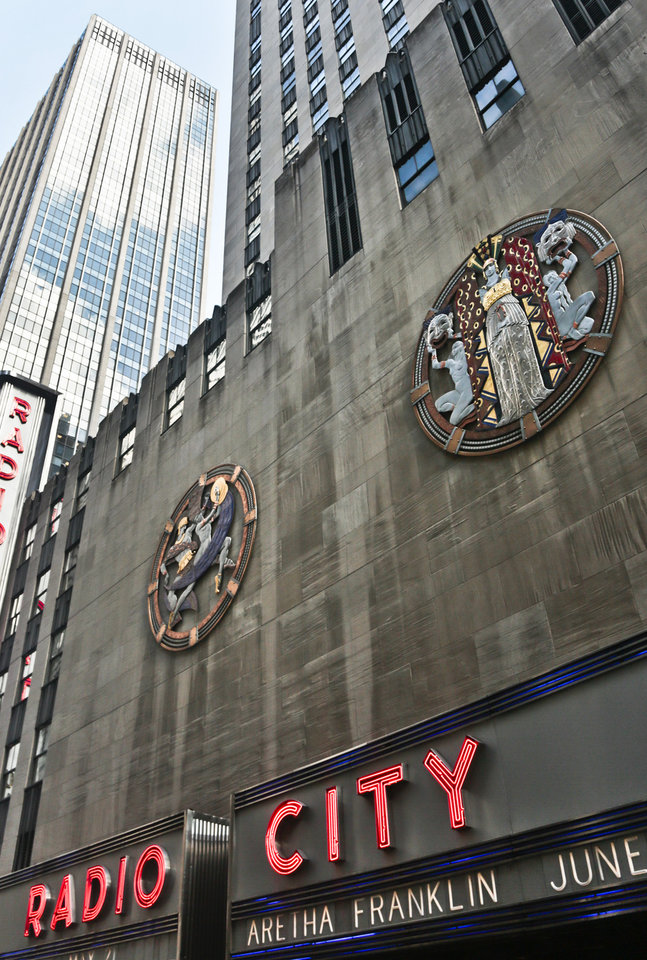 "Photo - In this March 24, 2014 photo, colossal metal-and-enamel roundels created by art deco muralist Hildreth Meiere  stand out on the facade of Radio City Music Hall  in New York.  ""The Art Deco Murals of Hildreth Meiere,"" a new book on the trail-blazing muralist who completed over 100 commissions in 16 states before her death in 1961, is set for May 1. (AP Photo/Bebeto Matthews)"
