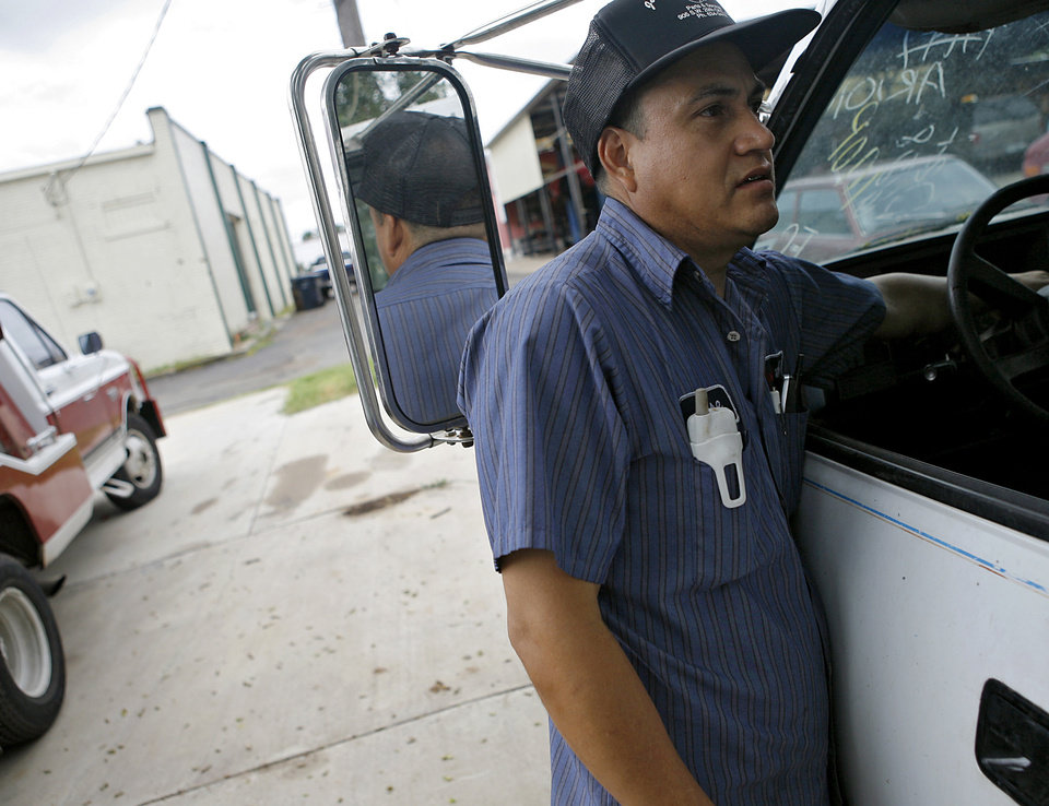 Photo - JOSE'S TRANSMISSIONS: Jose Realzola talks about his businesses around his shops near SW 44th and Western in Oklahoma City on Tuesday July 9, 2008. By John Clanton, The Oklahoman ORG XMIT: KOD