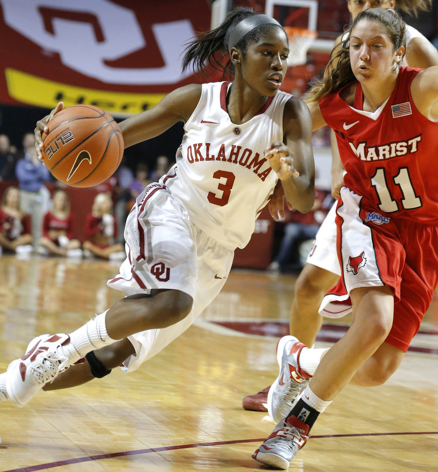 Oklahoma's Aaryn Ellenberg (3) drives to the basket as Marist's Leanne Ockenden (11) defends during the women's college basketball game between the University of Oklahoma and Marist at Lloyd Noble Center in Norman, Okla.,  Sunday,Dec. 2, 2012. Photo by Sarah Phipps, The Oklahoman