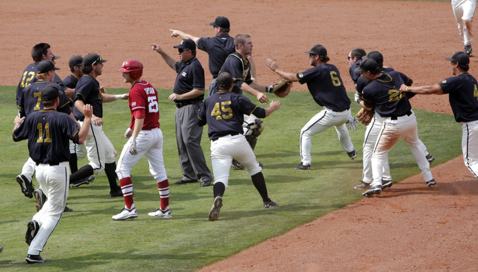 Oklahoma's Chase Simpson walks off the field as the University of Missouri celebrates the Big 12 conference tournament championship in Oklahoma City,  Sunday, May 27, 2012. Photo by Sarah Phipps, The Oklahoman.