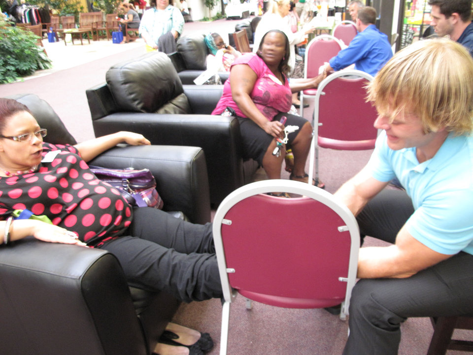 "Nicole Moore gets a foot massage from United Methodist Church of the Servant volunteer Derek Babb during the Single Parent Support Network's recent ""Queen For A Day"" event at the church, 14343 N MacArthur.Photo by Carla Hinton, The Oklahoman <strong></strong>"