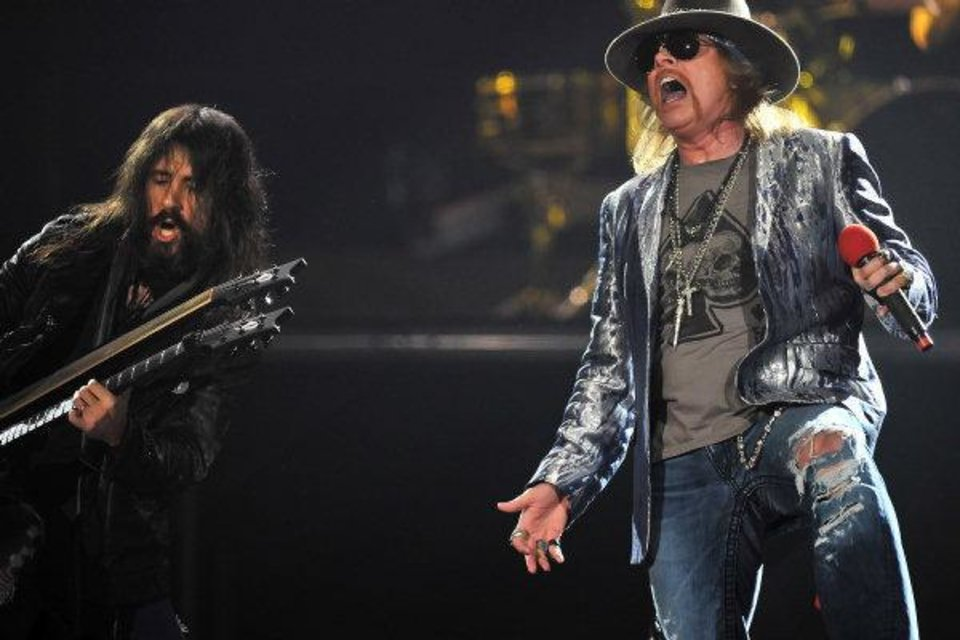 Photo - U.S. band Guns N' Roses guitarist Ron Thal and singer Axl Rose perform on their first night at London's O2 Arena, on Wednesday, Oct. 13 2010. (AP Photo/Mark Allan)
