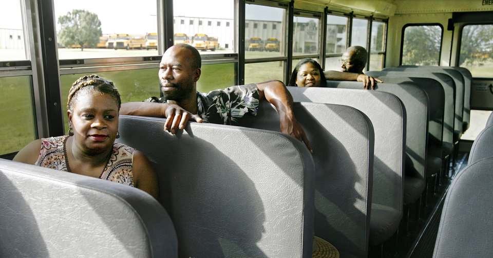 Bus driver trainees ride an Oklahoma City school bus at the district\'s transportation center in northeast Oklahoma City, Thursday, Aug. 7, 2008. At left is Gayla Smotherman. Behind her is Freddie Hudspeth. BY JIM BECKEL, THE OKLAHOMAN