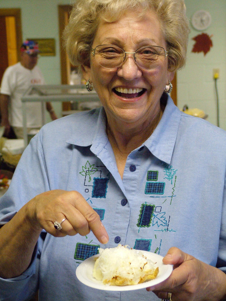 Shirley McKinney, Harrah United Methodist Church member, shows off the homemade pie she chose to accompany her meal at the 2005 version of the church's annual Thanksgiving Dinner. The community is invited to this year's dinner on Saturday, Nov. 11, from 4-7 pm. Meals may be purchased for eat-in or to take-out.<br/><b>Community Photo By:</b> Lin Archer<br/><b>Submitted By:</b> Lin, Harrah