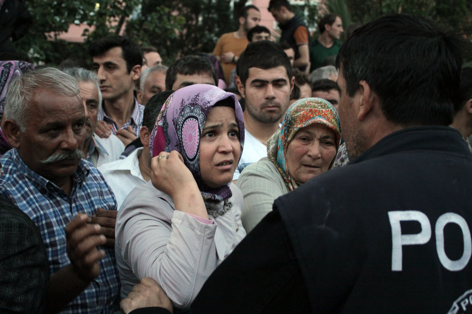 Photo - Relatives try to get information outside a local hospital after an explosion and fire at a coal mine in Soma, in western Turkey, Tuesday, May 13, 2014. Officials say that nearly 800 people were in the mine when the accident occurred.  (AP Photo/Depo Photos)