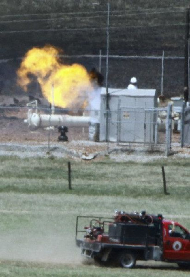 Photo - A fire burns Tuesday at the site of a natural gas pipeline  explosion in Grady County, west of Pocasset.   Photo by Steve Sisney, The Oklahoman ORG XMIT: KOD  STEVE SISNEY - THE OKLAHOMAN