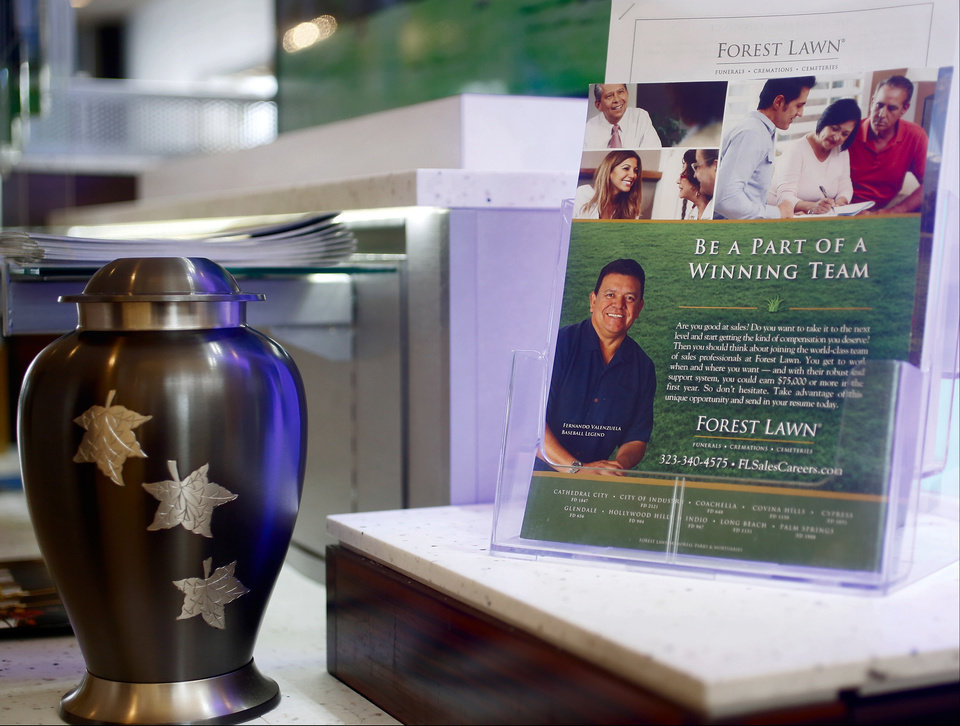 Photo - In this photo taken Thursday, Jan. 30, 2014, Mexican former Major League Baseball pitcher Fernando Valenzuela is pictured on the cover of a Forest Lawn promotional flyer at their stand at the Glendale Galleria mall in Glendale, Calif. Forest Lawn, famous as the final resting place for everyone from Al Jolson to Michael Jackson, has begun staffing outlets at shopping malls, reasoning that planning for death, either for a loved one or yourself, might not be quite as intimidating for some people if it takes place in a lively, happy place like a mall rather than the more somber confines of a cremation home. (AP Photo/Damian Dovarganes)
