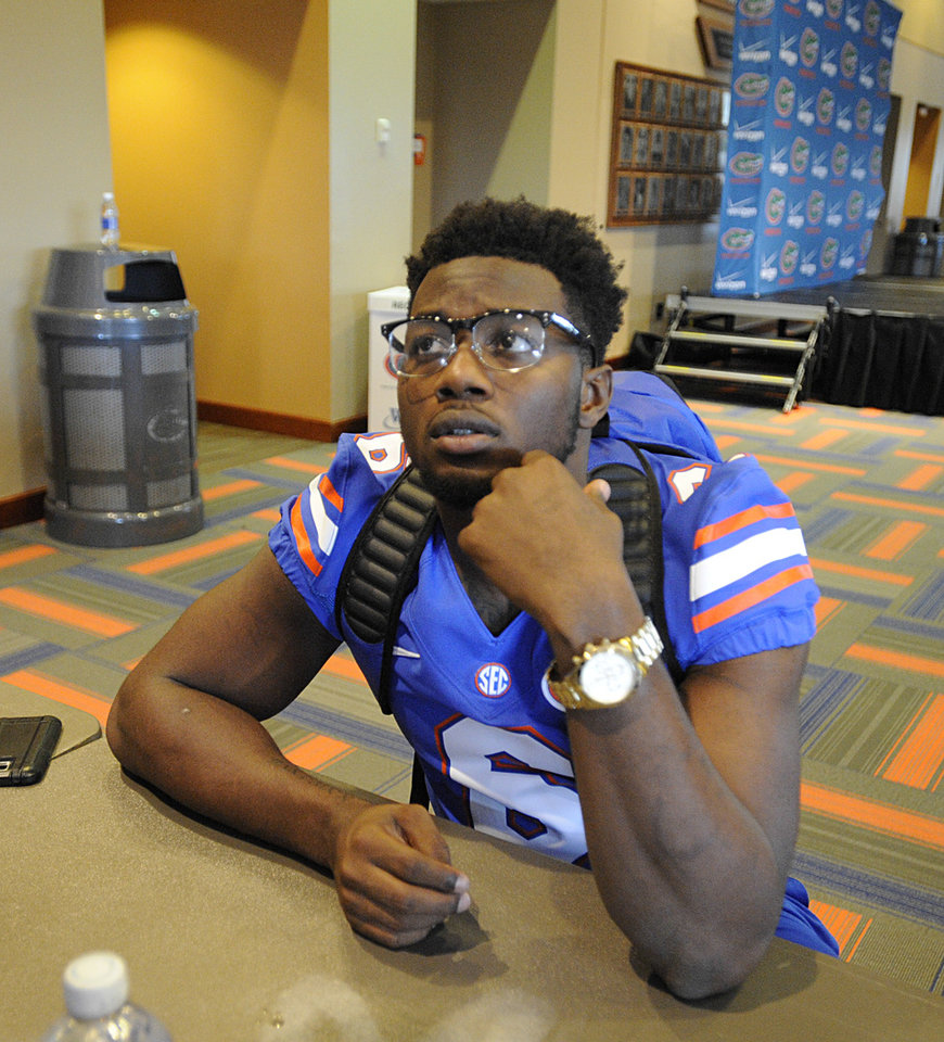 Photo - Florida NCAA college football player Dante Fowler, Jr. talks with reporters Sunday, Aug. 3, 2014, during the teams media day in Gainesville, Fla.  (AP Photo/Phil Sandlin)