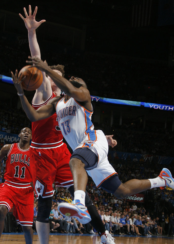 Oklahoma City\'s James Harden (13) drives to the basket as Chicago\'s Omer Asik (3) defends during the NBA basketball game between the Chicago Bulls and the Oklahoma City Thunder at Chesapeake Energy Arena in Oklahoma City, Sunday, April 1, 2012. Photo by Sarah Phipps, The Oklahoman
