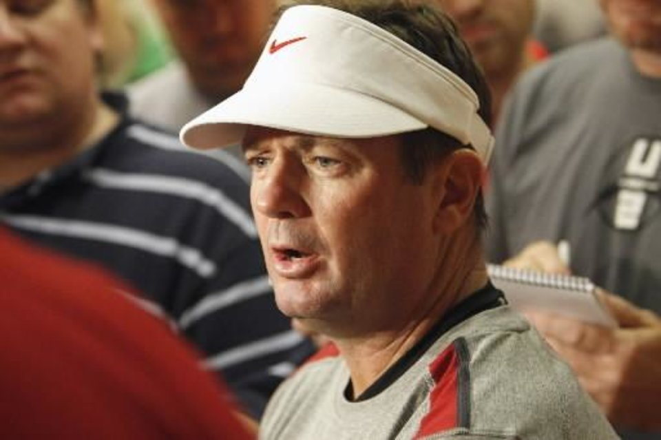 Head coach Bob Stoops speaks with the media following OU\'s first day of practice on Thursday, August 4, 2011, in Norman, Okla. Photo by Steve Sisney