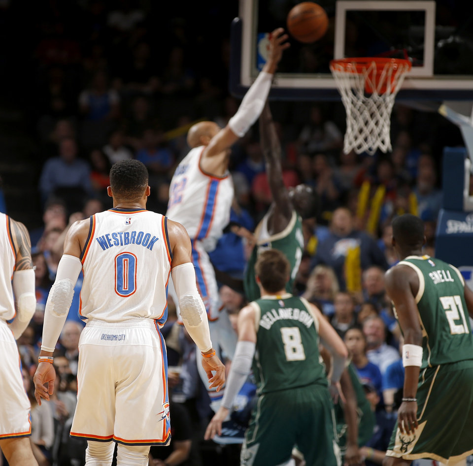 Photo - Oklahoma City's Russell Westbrook (0) gets his last assist for his 41st triple-double during an NBA basketball game between the Oklahoma City Thunder and the Milwaukee Bucks at Chesapeake Energy Arena in Oklahoma City, Tuesday, April 4, 2017. Westbrook tied Oscar Robertson's single-season triple-double record. Photo by Bryan Terry, The Oklahoman