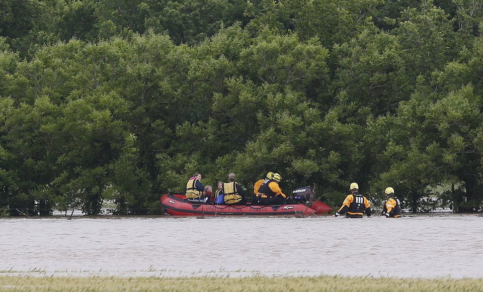 Photo - Emergency crews evacuate people from a high water area following heavy rains Tuesday, May 21, 2019 in El Reno, Okla. (AP Photo/Sue Ogrocki)