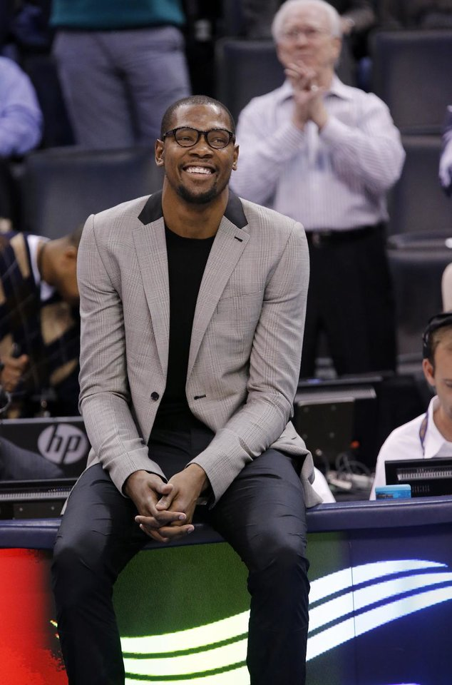 Kevin Durant smiles as he sits on the score table during the season finally NBA basketball game between the Oklahoma City Thunder and the Milwaukee Bucks at Chesapeake Energy Arena on Wednesday, April 17, 2013, in Oklahoma City, Okla.   Photo by Chris Landsberger, The Oklahoman