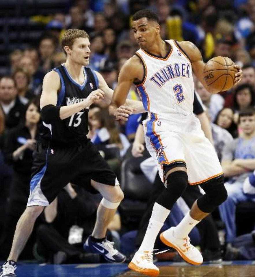 Oklahoma City's Thabo Sefolosha (2) works against Minnesota's Luke Ridnour (13) during an NBA basketball game between the Oklahoma City Thunder and Minnesota Timberwolves at Chesapeake Energy Arena in Oklahoma City, Friday, Feb. 22, 2013. Oklahoma City won, 127-111. Photo by Nate Billings, The Oklahoman Archives