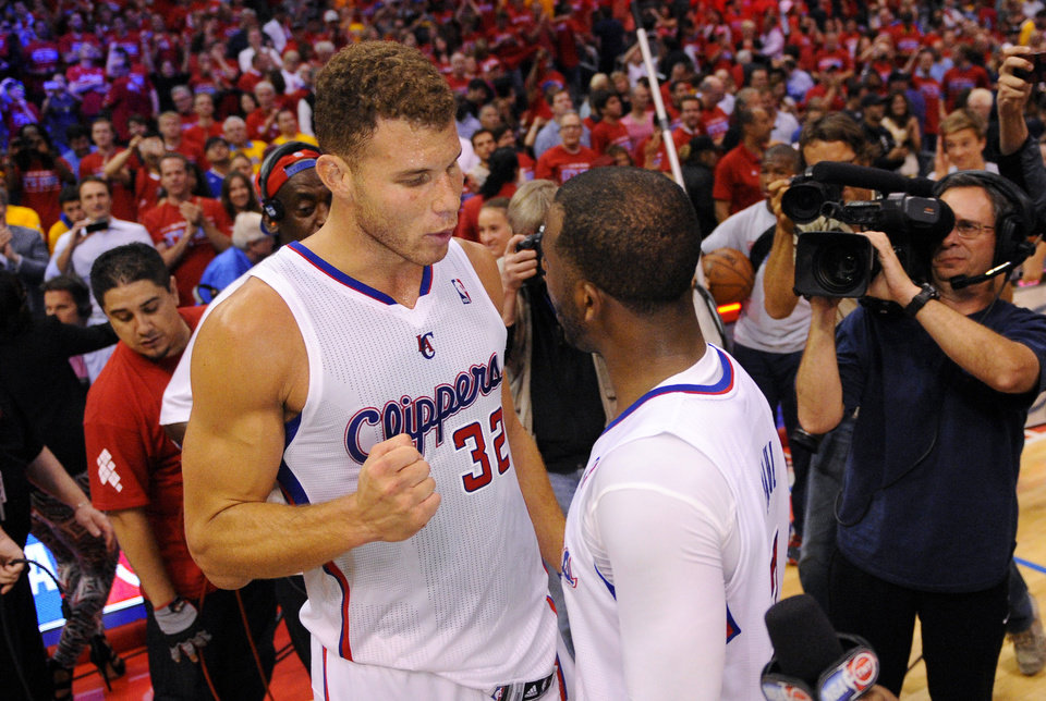 Photo - Los Angeles Clippers forward Blake Griffin, left, congratulates guard Chris Paul after defeating the Golden State Warriors in Game 7 of an opening-round NBA basketball playoff series, Saturday, May 3, 2014, in Los Angeles. The Clippers won 126-121. (AP Photo/Mark J. Terrill)