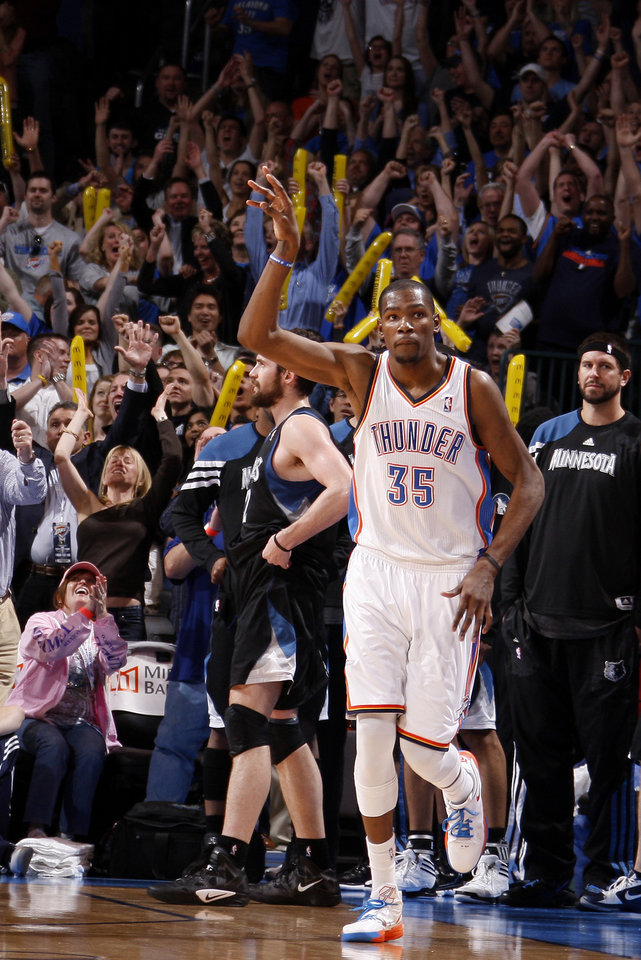 Oklahoma City's Kevin Durant (35) celebrates after making a three-point basket to send the game into a second overtime during the NBA basketball game between the Oklahoma City Thunder and the Minnesota Timberwolves at Chesapeake Energy Arena in Oklahoma City, Friday, March 23, 2012. Photo by Bryan Terry, The Oklahoman