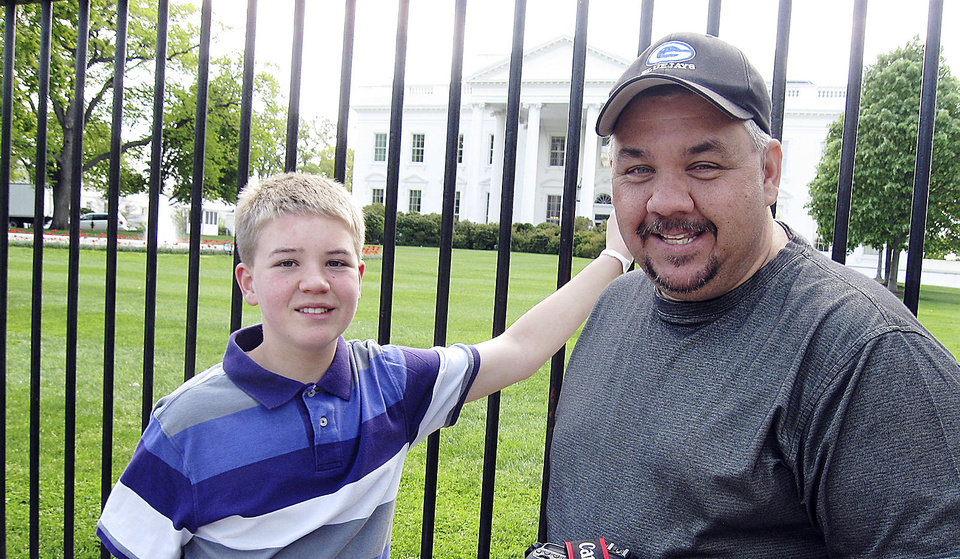 Mason Carter Harvey, left, and his father, Mike, stand in front of the White House on Monday after attending the Easter egg roll at first lady Michelle Obama�s invitation. Photo by Chris Casteel, The Oklahoman