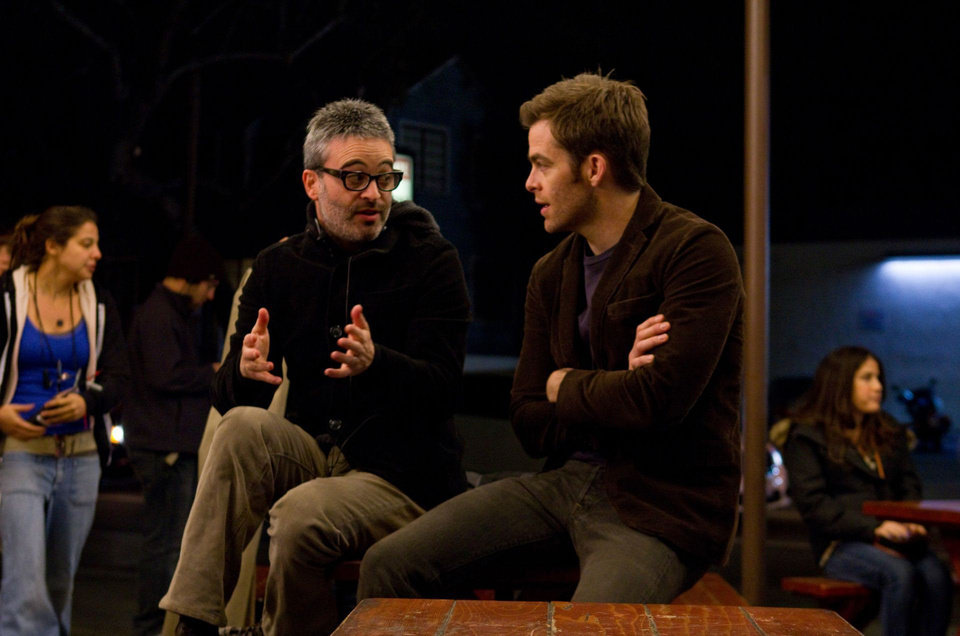 "Director/co-writer Alex Kurtzman, left, and actor Chris Pine talk on the set of their film ""People Like Us."" DreamWorks photo <strong></strong>"