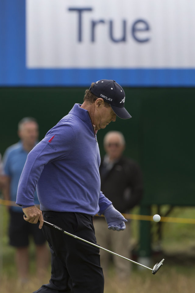Photo - Tom Watson of the US walks on the 6th green during a practice round at the Royal Liverpool Golf Club prior to the start of the British Open Golf Championship, in Hoylake, England, Monday, July 14, 2014. The 2014 Open Championship starts on Thursday, July 17. (AP Photo/Jon Super)
