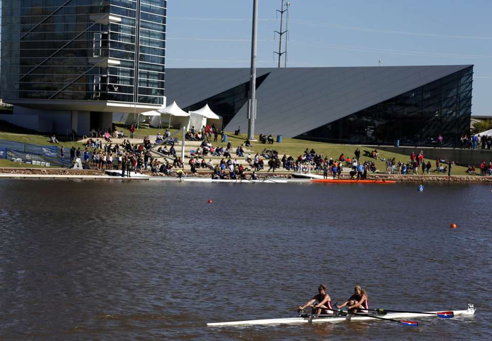 Photo - A team from Dallas A rows past spectators on the Oklahoma River during OCU Head of the Oklahoma & USRowing Masters National Head Race Championships, Sunday, Oct. 6, 2013, in Oklahoma City. Photo by Sarah Phipps, The Oklahoman