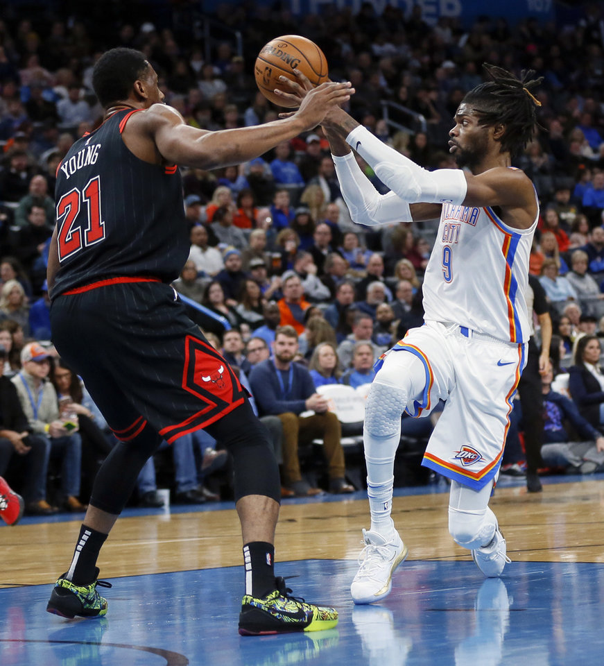 Photo - Oklahoma City's Nerlens Noel (9) passes away from Chicago's Thaddeus Young (21) in the first quarter during an NBA basketball game between the Oklahoma City Thunder and Chicago Bulls at Chesapeake Energy Arena in Oklahoma City, Monday, Dec. 16, 2019. [Nate Billings/The Oklahoman]