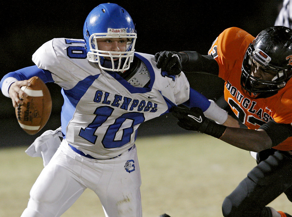 Glenpool's Connor Ferrell tries to get away from Douglass' Erik King (CQ)during their game at Moses F. Miller Stadium at Douglass High School in Oklahoma City on Friday, Oct. 29, 2010. Photo by John Clanton, The Oklahoman