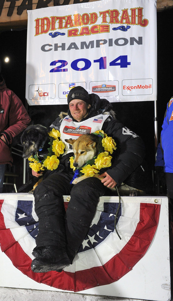 Photo - Dallas Seavey sits under the burled arch in Nome, Alaska after winning the 2014 Iditarod Trail Sled Dog Race, Tuesday, March 11, 2014.  (AP Photo/The Anchorage Daily News, Bob Hallinen)  LOCAL TV OUT (KTUU-TV, KTVA-TV) LOCAL PRINT OUT (THE ANCHORAGE PRESS, THE ALASKA DISPATCH)