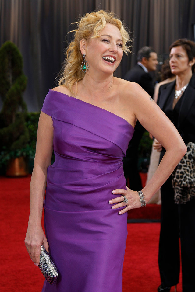 Virginia Madsen arrives before the 84th Academy Awards on Sunday, Feb. 26, 2012, in the Hollywood section of Los Angeles. (AP Photo/Amy Sancetta) ORG XMIT: OSC218