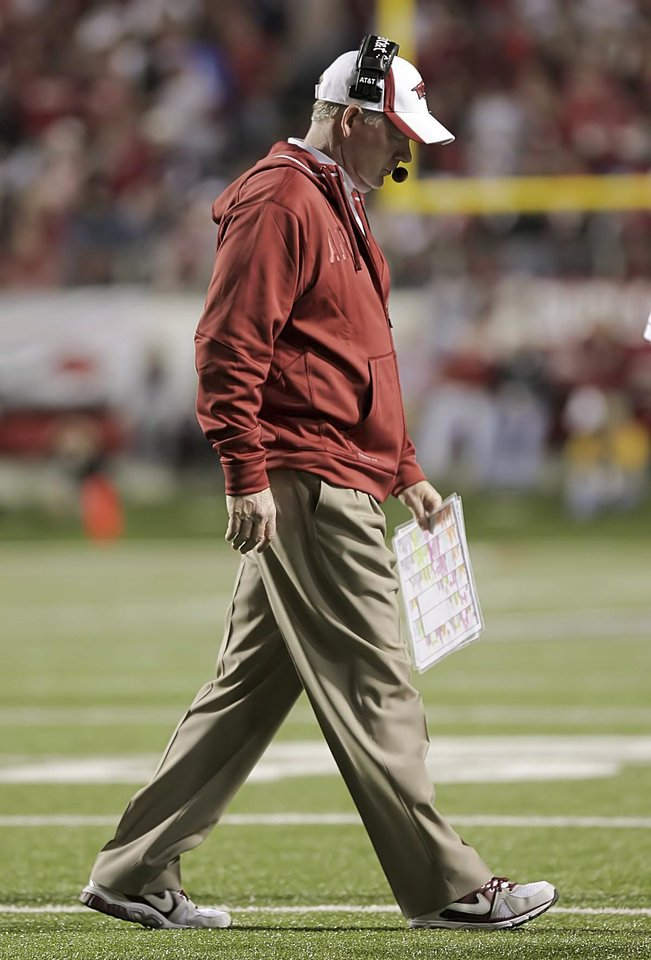 Photo -   In this Nov. 19, 2011, photo, Arkansas football coach Bobby Petrino walks to the sideline as the Razorbacks took on Mississippi State during an NCAA college football game in Little Rock, Ark. Arkansas fired coach Petrino on Tuesday, April 10, 2012, publicly dressing him down for unfairly hiring his mistress and intentionally misleading his boss about everything from their relationship to her presence at the motorcycle accident that ultimately cost him his job. (AP Photo/El Dorado News-Times, Michael Orrell) MANDATORY CREDIT