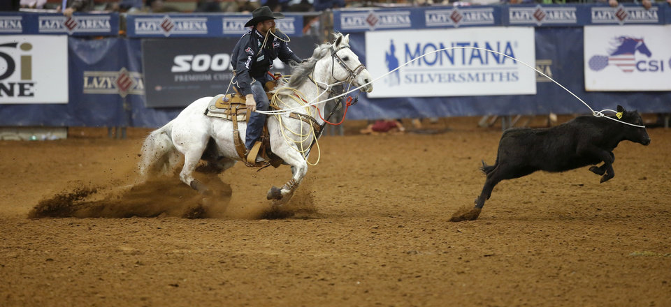 Photo - Clayton Hass of Weatherford, Texas,  competes in the tie-down roping event during the Timed Event Championship inside the Lazy E Arena in Guthrie, Okla., Friday, March 13, 2020. [Bryan Terry/The Oklahoman]