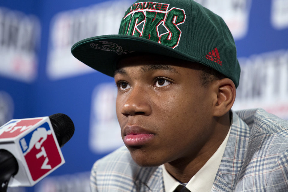Photo - Greece's Giannis Antetokounmpo, picked by the Milwaukee Bucks in the first round of the NBA basketball draft, speaks during a news conference Thursday, June 27, 2013, in New York. (AP Photo/Craig Ruttle)