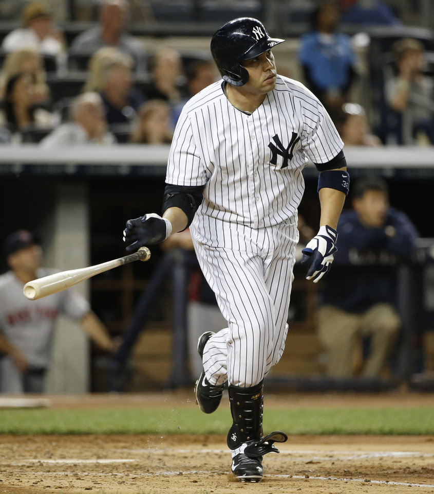 Photo - New York Yankees designated hitter Carlos Beltran tosses his bat after hitting a fourth-inning, solo home run off Boston Red Sox starting pitcher John Lackey in a baseball game at Yankee Stadium in New York, Sunday, June 29, 2014.  (AP Photo/Kathy Willens)