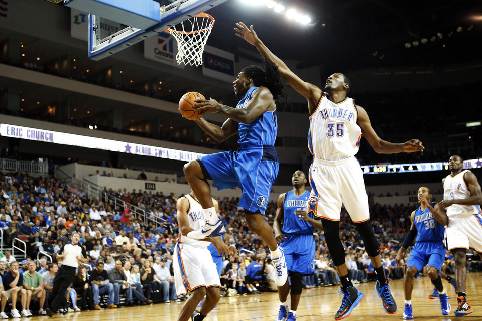 Dallas Mavericks' Jae Crowder shoots past Oklahoma City Thunder's Kevin Durant during their preseason NBA basketball game, Wednesday, Oct. 24, 2012, in Wichita, Kan. (AP Photo/The Wichita Eagle, Jaime Green) LOCAL TV OUT; MAGS OUT; LOCAL RADIO OUT; LOCAL INTERNET OUT ORG XMIT: KSWIE103