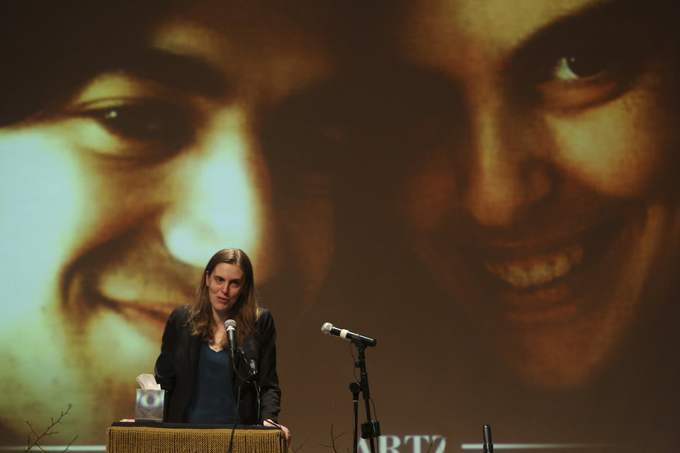 Photo - Taren Stinebrickner-Kauffman, Aaron Swartz's partner and Founder and Executive Director of SumOfUs.org, speaks during his memorial service, Saturday, Jan. 19, 2013 in New York. Friends and supporters of Swartz paid tribute Saturday to the free-information activist and online prodigy, who killed himself last week as he faced trial on hacking charges. (AP Photo/Mary Altaffer)
