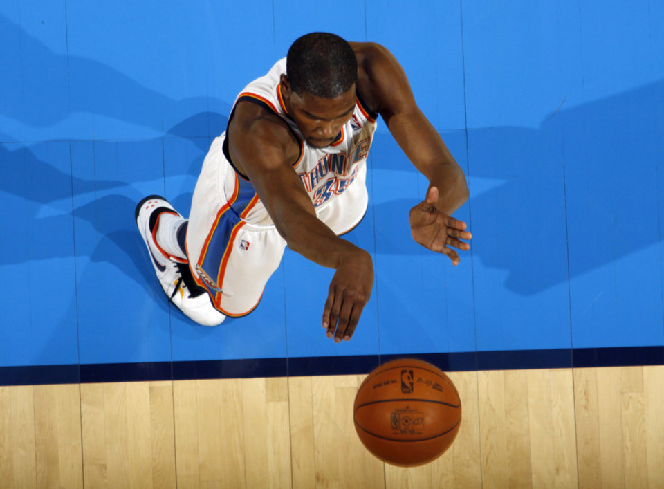 Photo - Oklahoma City's Kevin Durant (35) shoots a free-throw during the NBA basketball game between the Oklahoma City Thunder and the Phoenix Suns, Sunday, Dec. 19, 2010, at the Oklahoma City Arena. Photo by Sarah Phipps, The Oklahoman