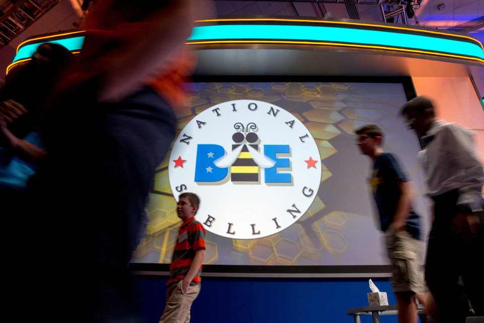 Photo - Spellers leave the stage during the 2105 Scripps National Spelling Bee, Wednesday, May 27, 2015, in Oxon Hill, Md. (AP Photo/Andrew Harnik)