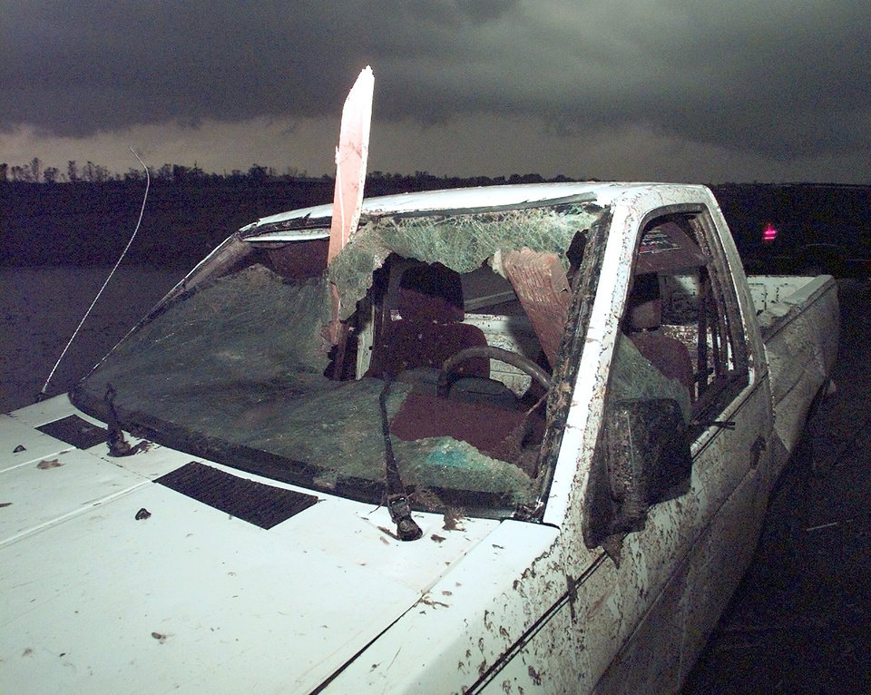 MAY 3, 1999 TORNADO: THIS TRUCK SHOWS THE FORCE OF THE TORNADO THAT PASSED THREW MOORE AS IT IMPALED 2 BY 4'S IN THIS TRUCK ON 12TH AND SANTA FE IN MOORE.